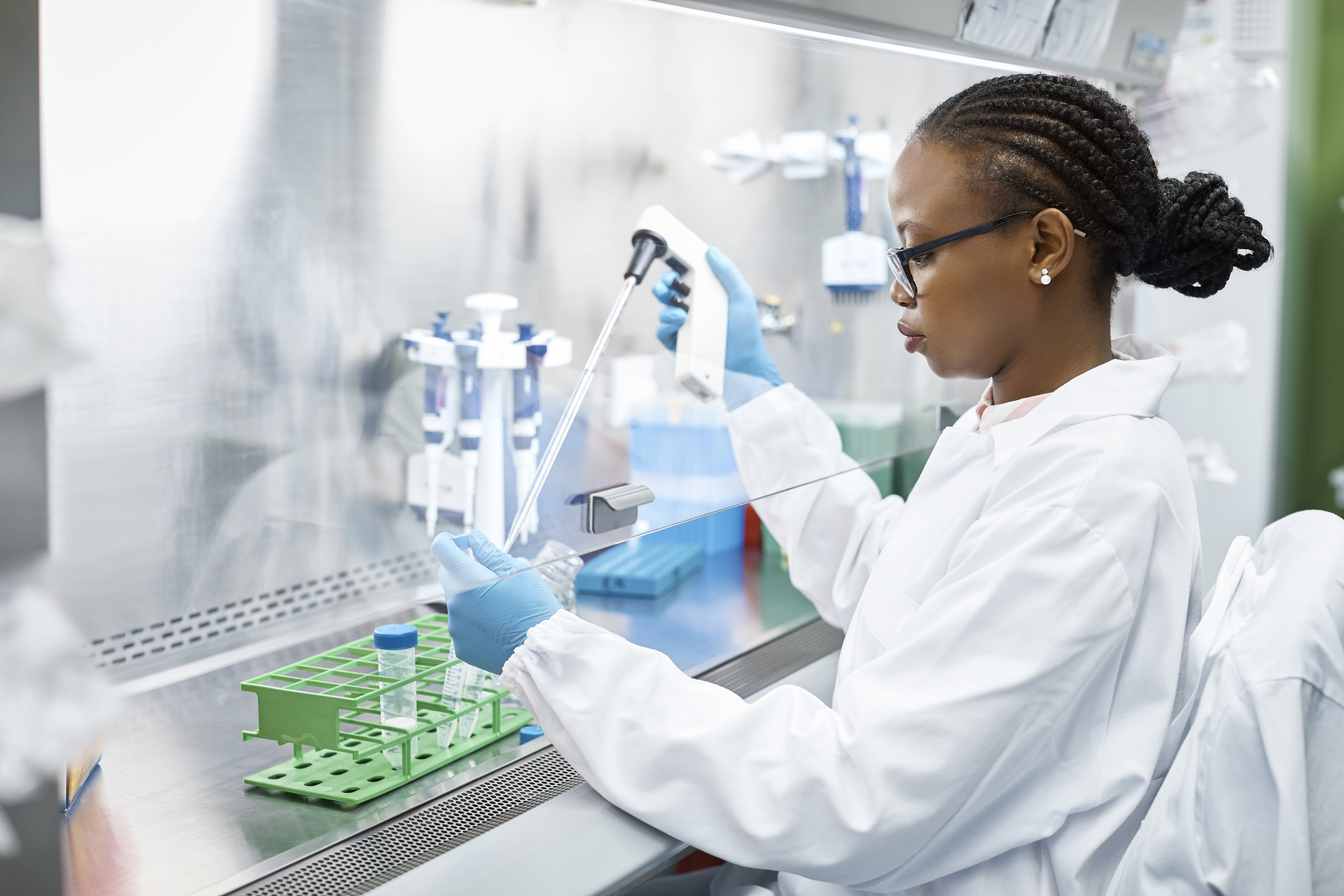 scientist-analyzing-medical-sample-in-laboratory